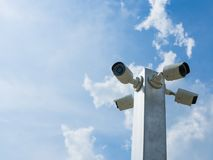 Closed-circuit television or CCTV Security camera on blue sky background.  royalty free stock photography
