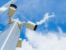 Closed-circuit television or CCTV Security camera on blue sky background.  royalty free stock image