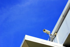 Closed  circuit  television surveillance  camera. On  blue sky background Stock Photos