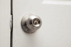 Closed closet door knob. Plenty of copy space stock photos