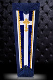 Closed coffin covered with blue and white cloth decorated with Church gold cross on gray background. Vertical position. Royalty Free Stock Photos