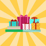 Closed colored boxes with gifts on the background of yellow rays. Vector illustration. Closed colored boxes with gifts on the background of yellow rays. The Royalty Free Stock Image