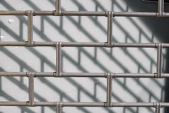 Closed concept. Closed grate of a shop with hard dramatic shadow Stock Photography