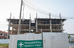 Closed Construction Site with Safety First Sign in Thai Stock Photo