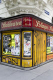 Closed corner shop. A closed corner shop with graffiti writing on its blinds in central Vienna, Austria stock image