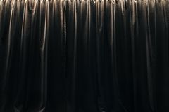 Closed curtain of black velvet curtains. Part of the interior royalty free stock photo