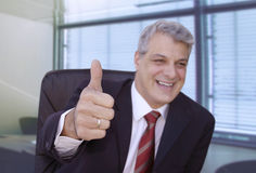 Closed deal. Happy businessman in his office Stock Photography