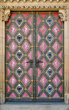 Closed decorated cathedral door Stock Photography