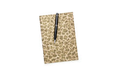 Closed diary with golden pattern on cover Royalty Free Stock Image
