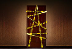 Closed dooor with yellow Police tape Royalty Free Stock Photo