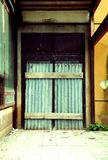 Closed door. Closed metal door with wooden latches Royalty Free Stock Image