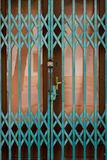 Closed door. With protective steel grid Royalty Free Stock Photography