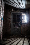 Closed door at abandoned factory Stock Image