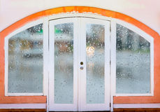 Closed door arch  rainy autumn weather Stock Photography