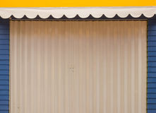 Closed door background. Closed white door with yellow and blue color background pattern texture Stock Image
