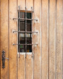Closed door with barred window. Stock Photography