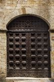 Closed door of a building in the medieval town of San Gimignano Royalty Free Stock Photos