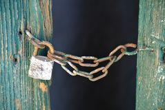 Closed door by chain and padlock. The  closed door by chain and padlock Royalty Free Stock Photo