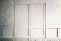Closed door. Concrete wall and white closed door Stock Photo
