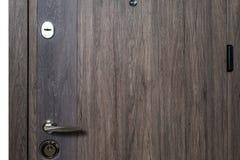 Closed door.Dark brown wooden door closeup. Modern interior design, door handle. New house concept. Real estate. Closed door.Dark brown wooden door closeup Stock Photo
