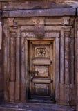 Closed Door - with granite pillars and wall around. Purple / Magenta coloured Granite rocks forming the walls and the floor at the badami temple, karnataka royalty free stock photo