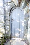 Closed door Grey color construct with strong stone wall. Grey color Closed door entrance view construct with strong stone wall royalty free stock photo