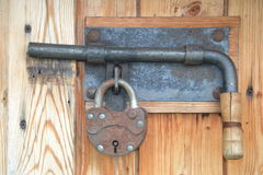 Closed door with a heck and padlock Royalty Free Stock Photo