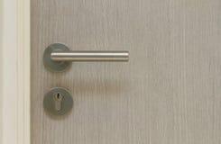 Closed door with metal door knob Royalty Free Stock Photography