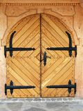 Closed door - no entrance. A massive hand made wooden entrance door Royalty Free Stock Photography
