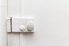 Closed door with vintage white painted lock Royalty Free Stock Image