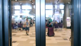 Closed doors of lift at the airport. Blurred airport on background Royalty Free Stock Photos