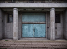 Closed doors in a old derelict office building Stock Images