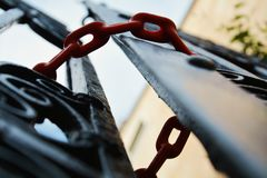 Closed doors by red chains. Background Royalty Free Stock Photo