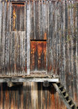 Closed doors and staircase in the wall of old wooden house.  Stock Photography