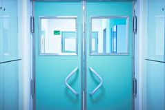 Closed doors in the operating room. Closed doors with windows in the operating room Stock Image