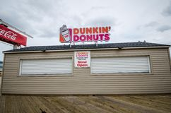 Closed Dunkin Donuts Restaurant Store - Seaside Heights, NJ. Closed for the season, on the boardwalk of the Jersey Shore Stock Photography