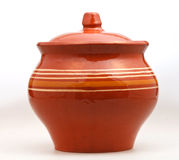 Closed earthenware pot on white Royalty Free Stock Image