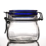 Closed empty glass jar Royalty Free Stock Image