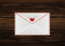 Closed envelope with hearts on the perimeter. Valentine`s Day. G. Reeting card. Vector illustration on wooden background Stock Images