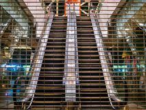 Closed escalators seen through a shuttered entrance to a department store in Tianhe district, Guangzhou, China royalty free stock images