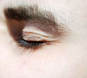 Closed eye. Beautiful closed eye young guy Stock Image