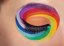 Closed eye with colors spectrum make up around it Stock Photography