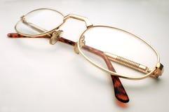 Closed eyeglasses. On white background Stock Photos