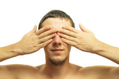 Closed eyes. Man closes his eyes with his hands Stock Image
