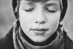 Closed eyes. A pretty boy with closed eyes Stock Image