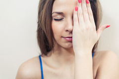 Closed eyes women hiding her eye by hand Stock Photo