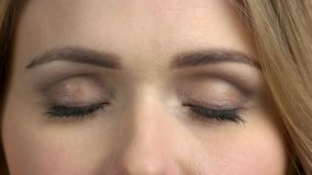 Closed eyes of young caucasian woman. Young beautiful woman opens her yes close up. Mirror of the soul stock video