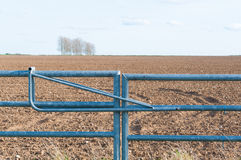 Closed farmland metal gate in England Royalty Free Stock Image