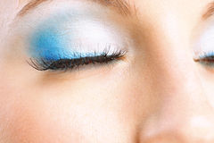 Closed female eye. With blue ink close up Stock Image