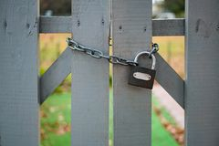 Closed fence with small chain and lock. Closed wooden fence with small chain and lock. close up outdoor shot. no trespass stock images